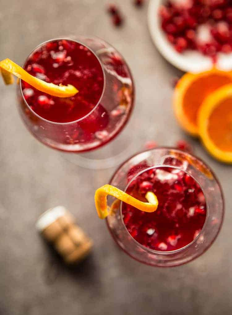 A top down look at two Pomegranate  Champagne cocktails