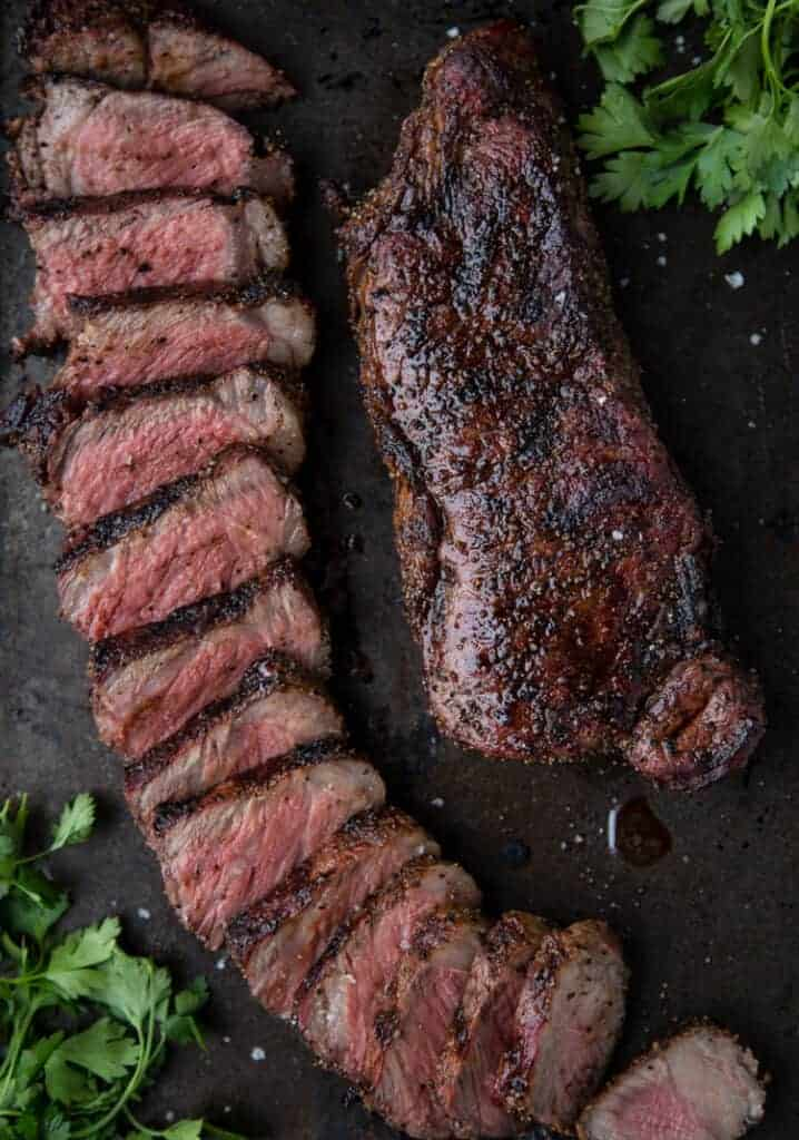 A perfect grilled steak, cooked to perfection and sliced