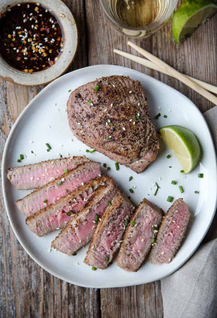Grilled Tuna Steaks on a platter with a soy dipping sauce