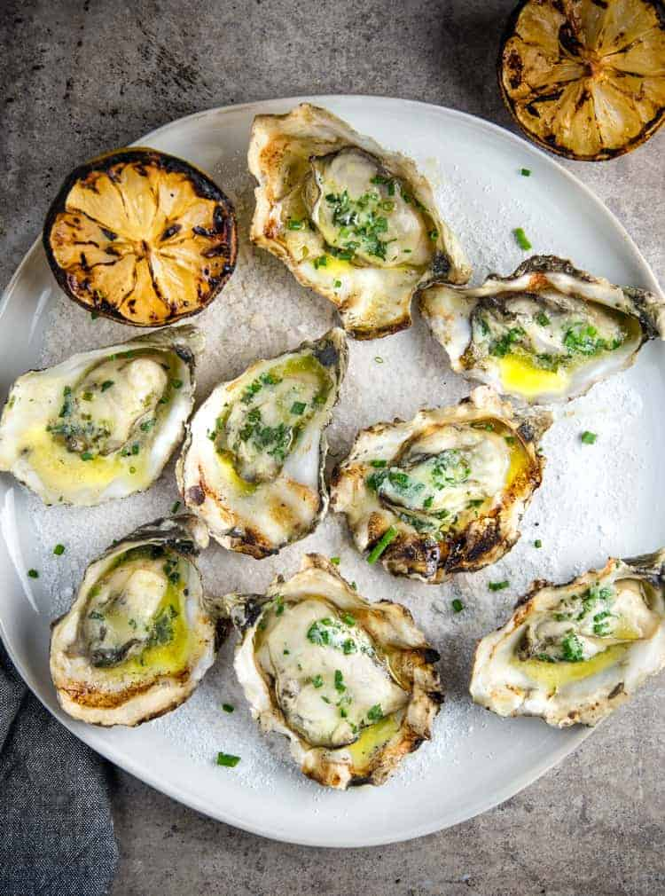 Grilled Oysters served with a wine butter sauce