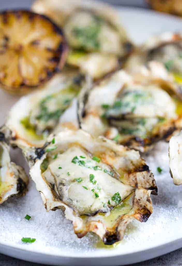 Grilled Oyster on a platter with salt