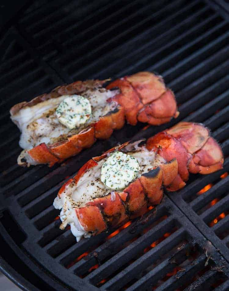 Grilling Lobster Tails topped with an herbed compound butter