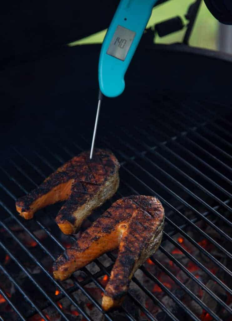 Taking temperature meat with a digital Thermapen thermometer
