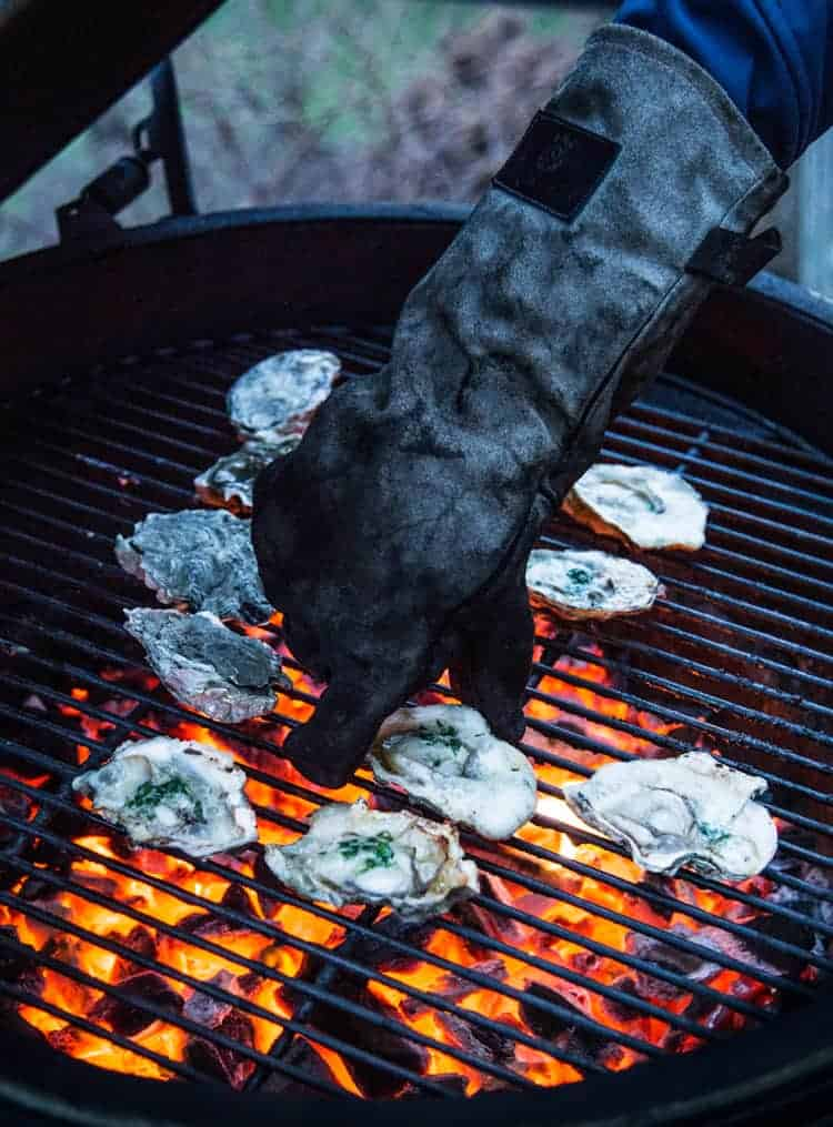 Using heat resistant gloves to remove hot items from a hot grill