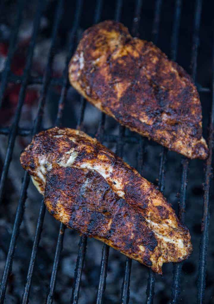 Two chicken breasts on the grill