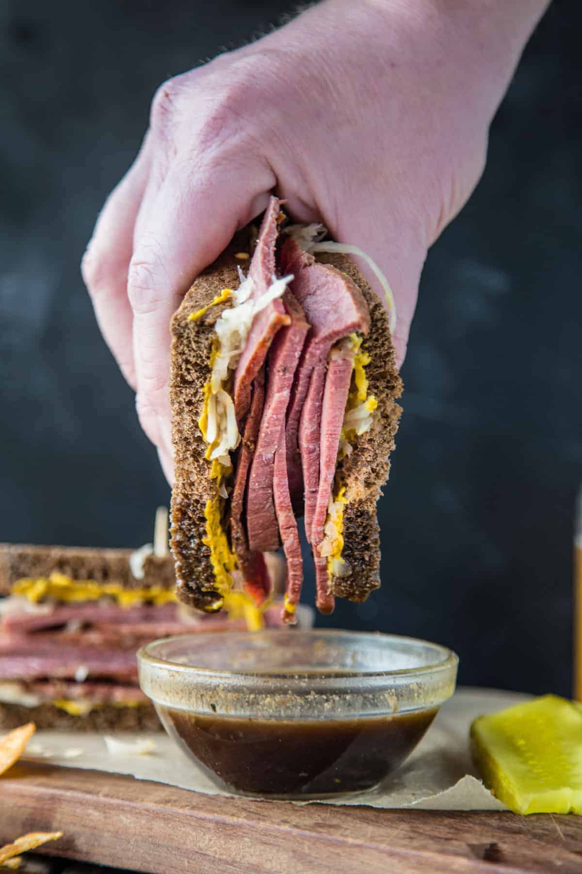 Dipping a Corned Beef Sandwich in Guinness Au Jus dipping sauce