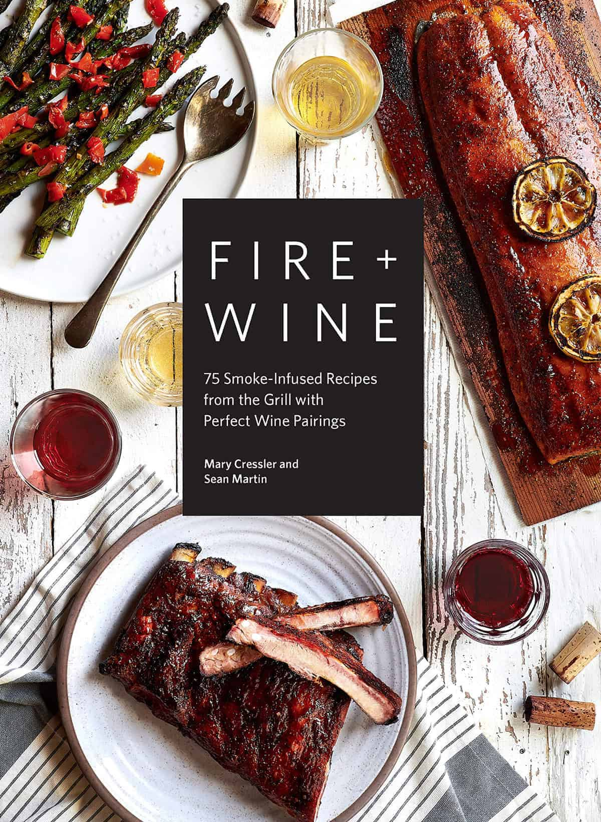 Fire and Wine Cookbook cover photo featuring cedar plank salmon, ribs, and asparagus with spicy peppers.