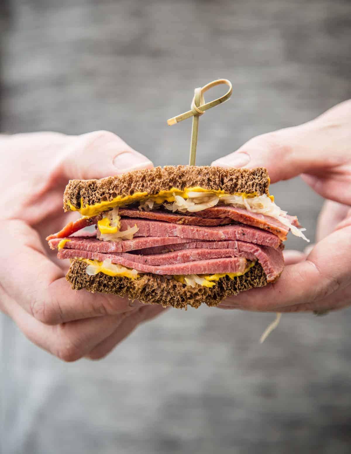 Holing a Smoked Corned Beef Sandwich