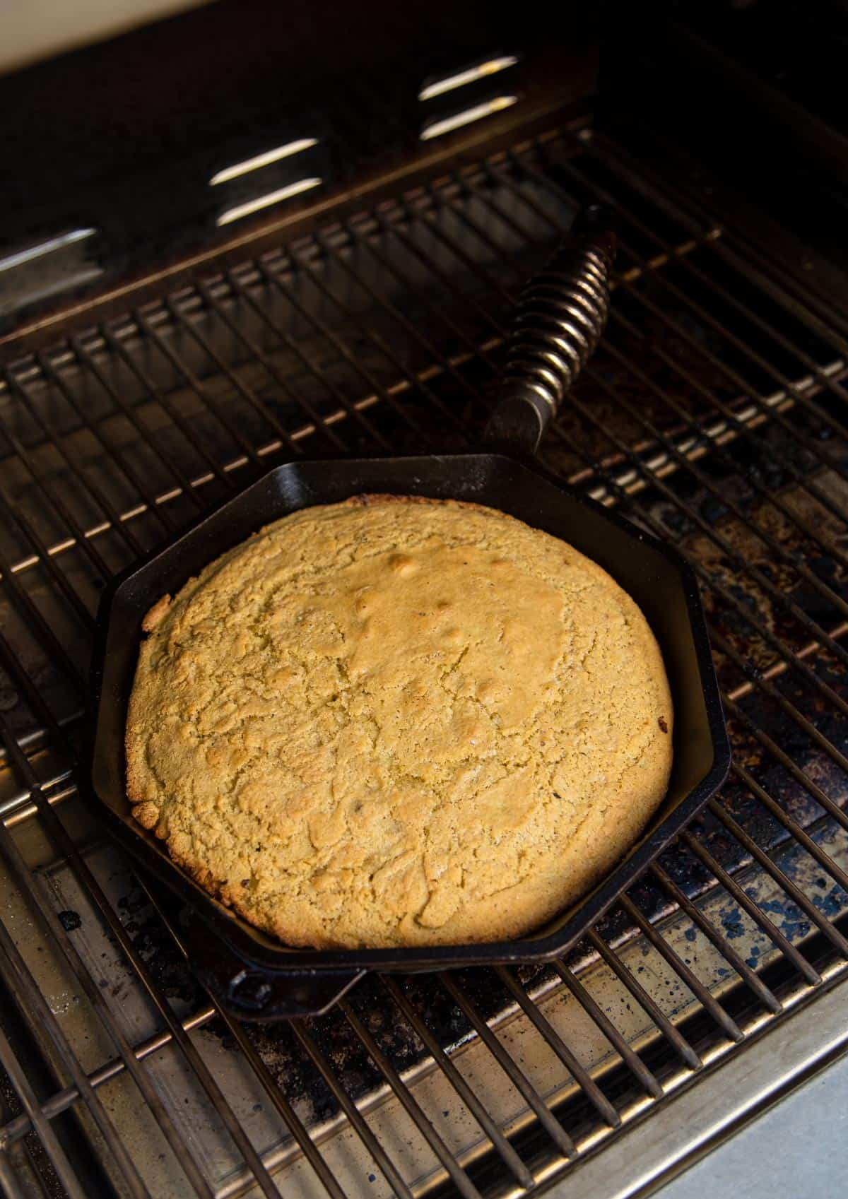 Cornbread cooked in the grill in a cast iron pan