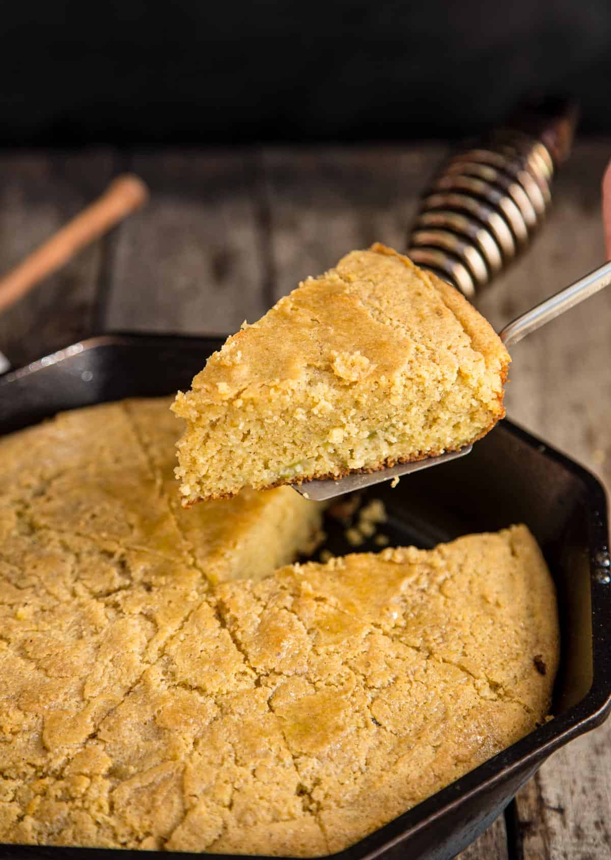 A slice of Cast Iron Skillet Cornbread made with gluten free flour