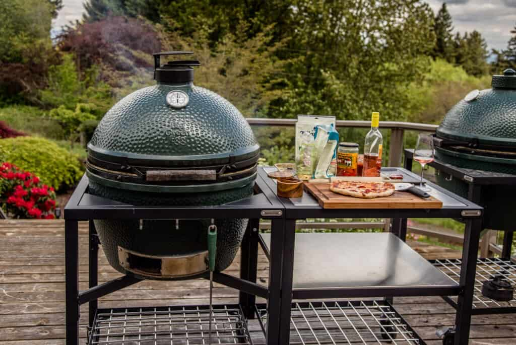 A Big Green Egg Grill set up and ready to grill pizza