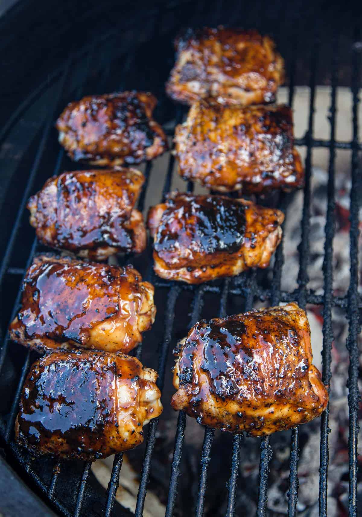 Chicken Thighs being cooked over indirect heat on a Big Green Egg grill