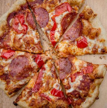 A grilled pepperoni and hot pepper pizza, cut into 6 slices