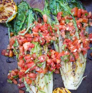 grilled romaine topped with tomato basil mixture