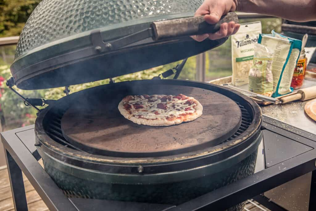 Grilling a pizza on a Big Green Egg grill