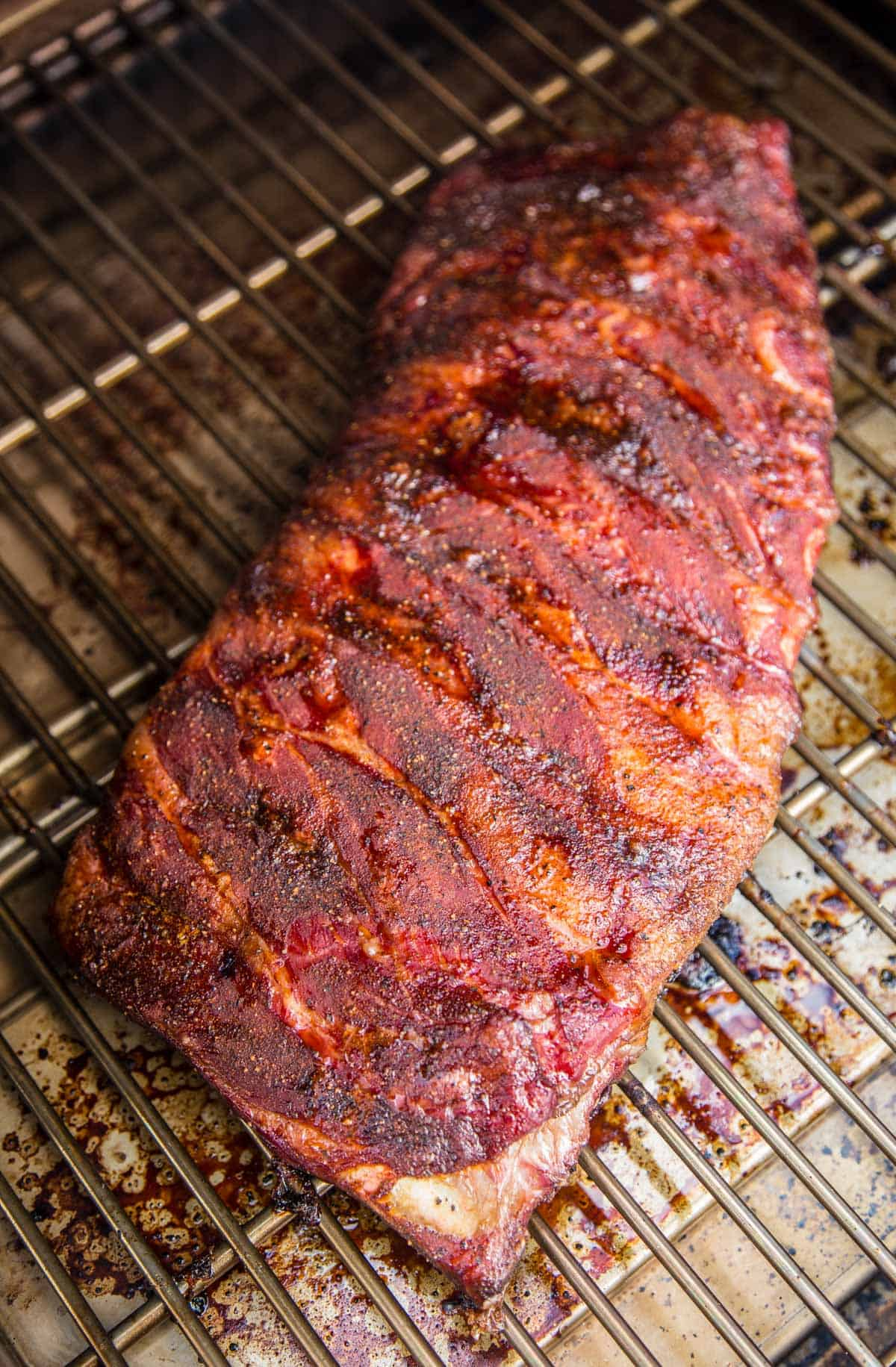 Smoked Pork Ribs being cooked on a MAC pellet grill