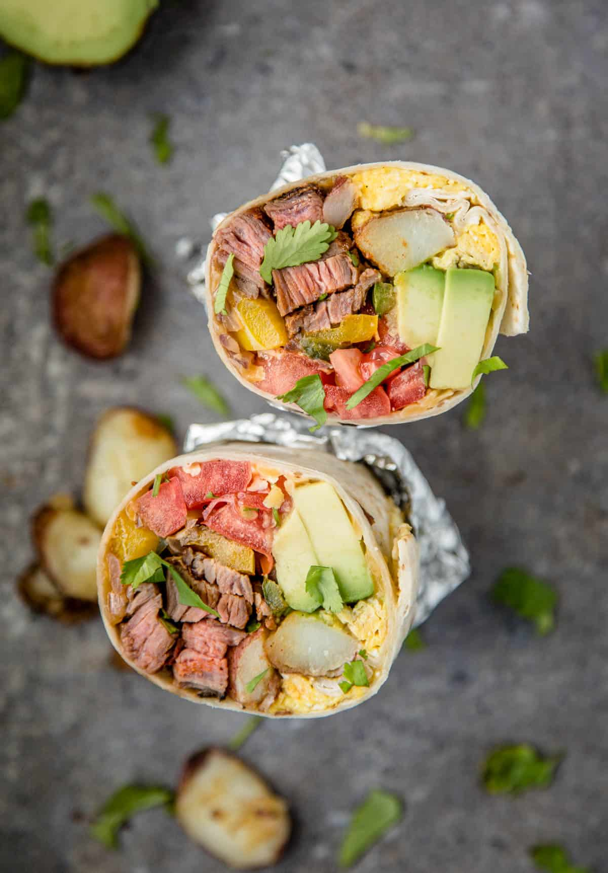 A Steak and Egg Breakfast Burrito cut in half