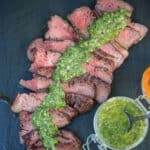 Tri Tip sliced with a chimichurri sauce poured over top