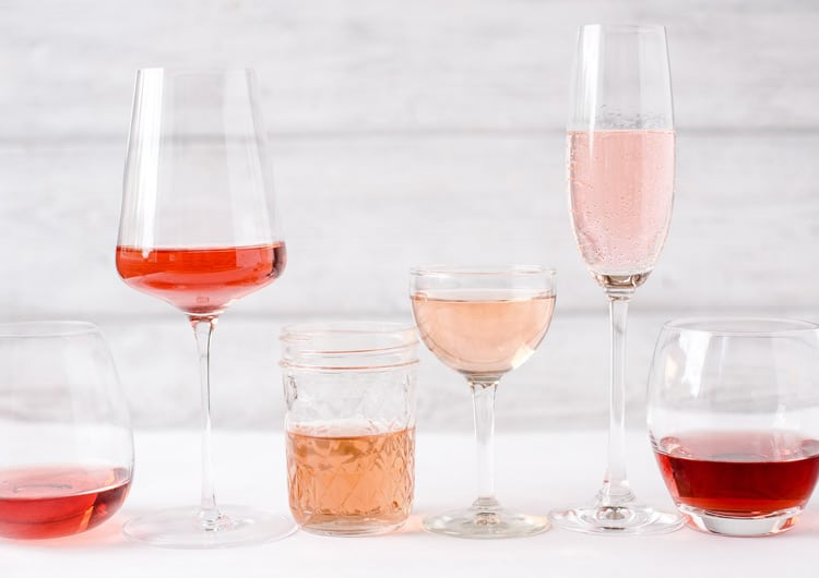Different glasses with various styles of rose wine