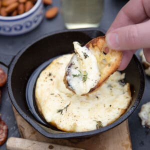Baked Brie dip with crostini.