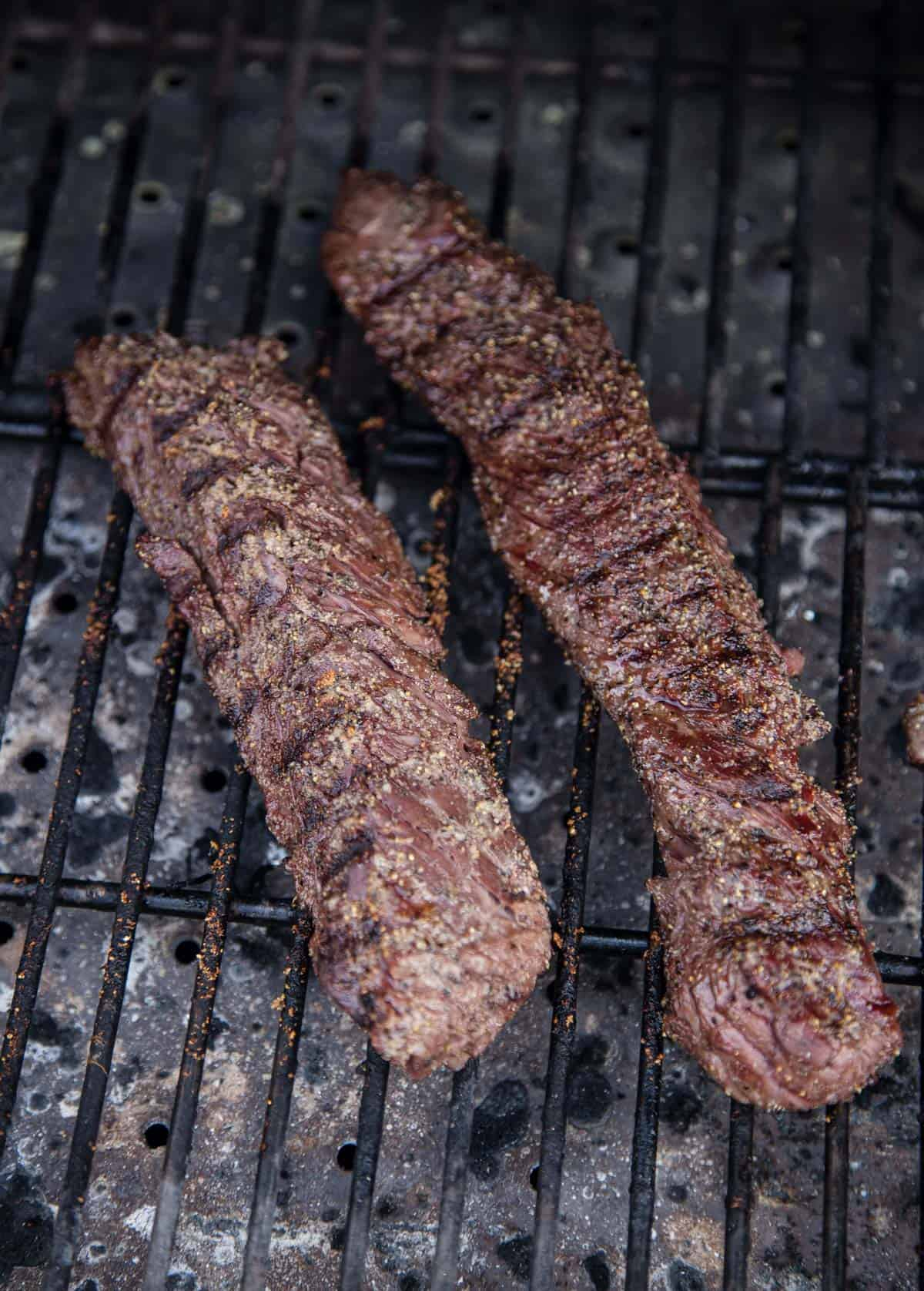 2 Hanger Steaks cooking on a grill