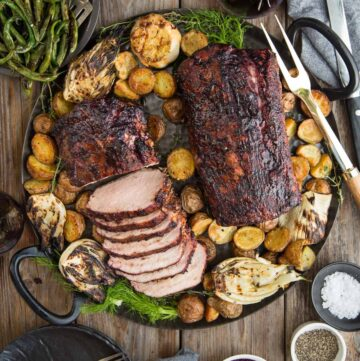Pork Loin with Blackberry Wine Glaze on a platter with roasted potatoes