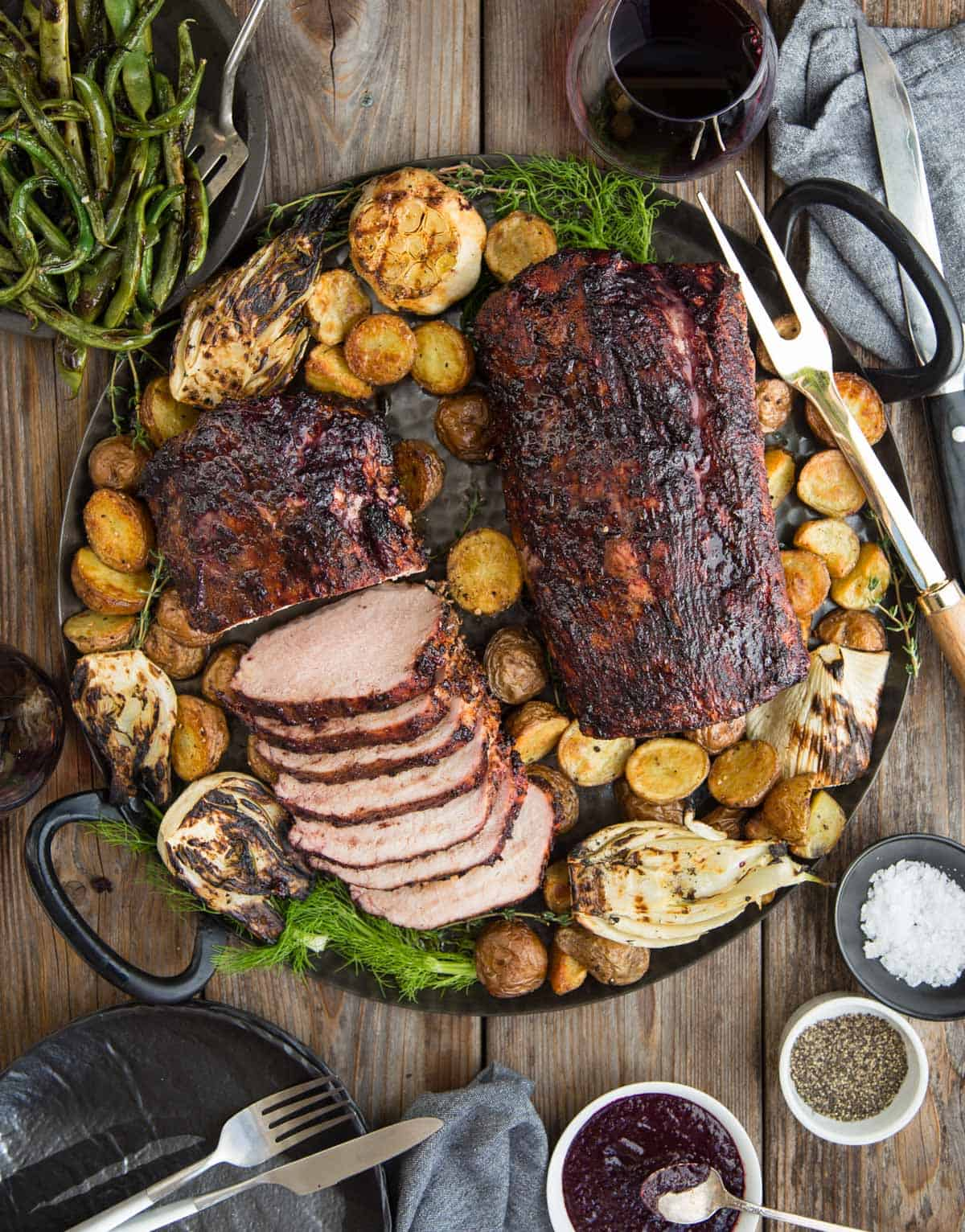 Grilled Pork Loin with Blackberry Wine Glaze on a platter with roasted potatoes