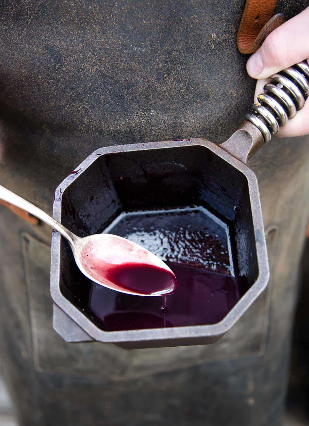 Pinot Noir wine and Marionberry reduction sauce in a small saucepan
