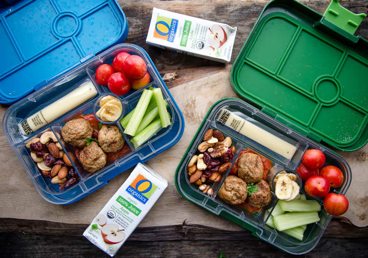 Two bento boxes filled with school lunch ideas.