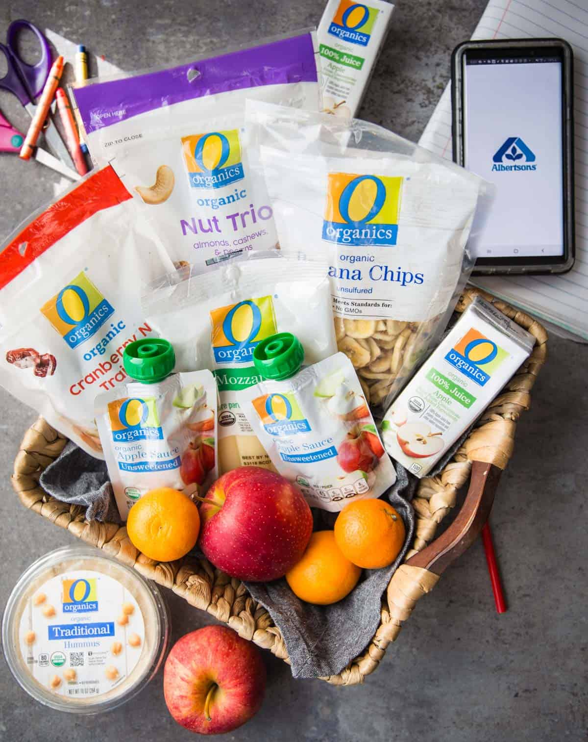 A basket full of O Organics snacks.