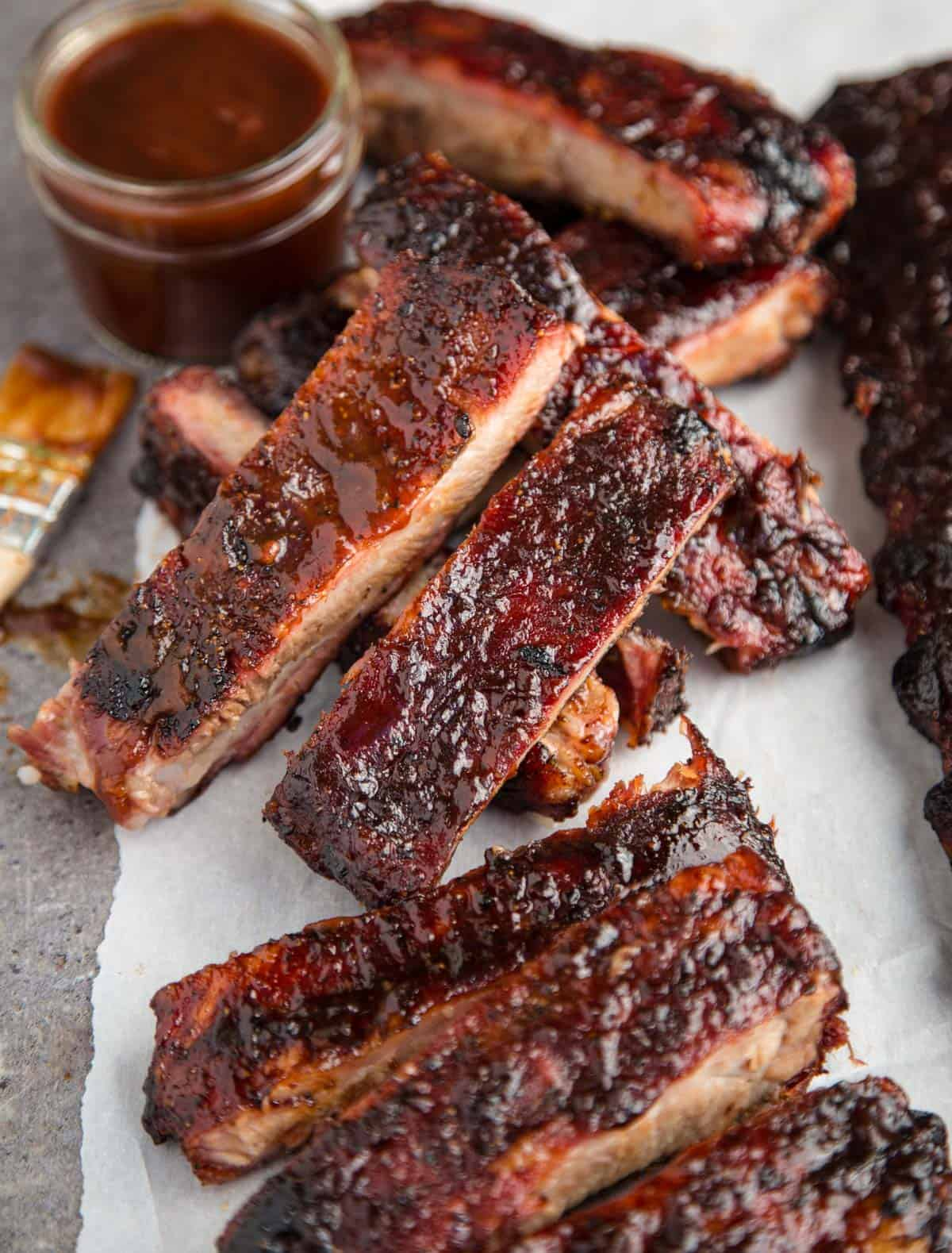 Pellet Grill Smoked Ribs sliced into individual ribs with Kansas City Style BBQ sauce on them