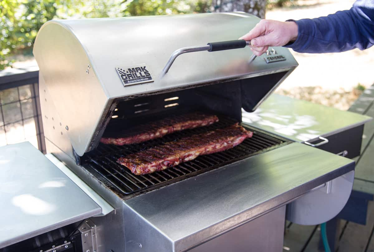 MAK Two Star General Pellet Grill with Ribs cooking on it
