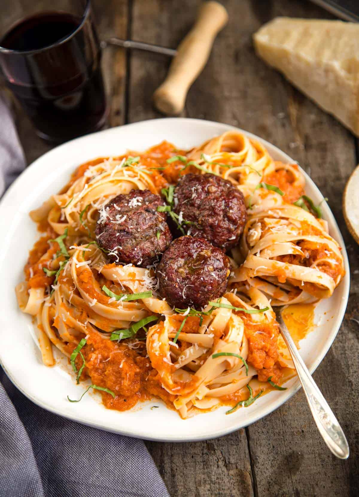 A bowl of smoke roasted tomato sauce with pasta and meatballs