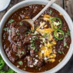 Authentic Beef Chili with cheese and toppings.