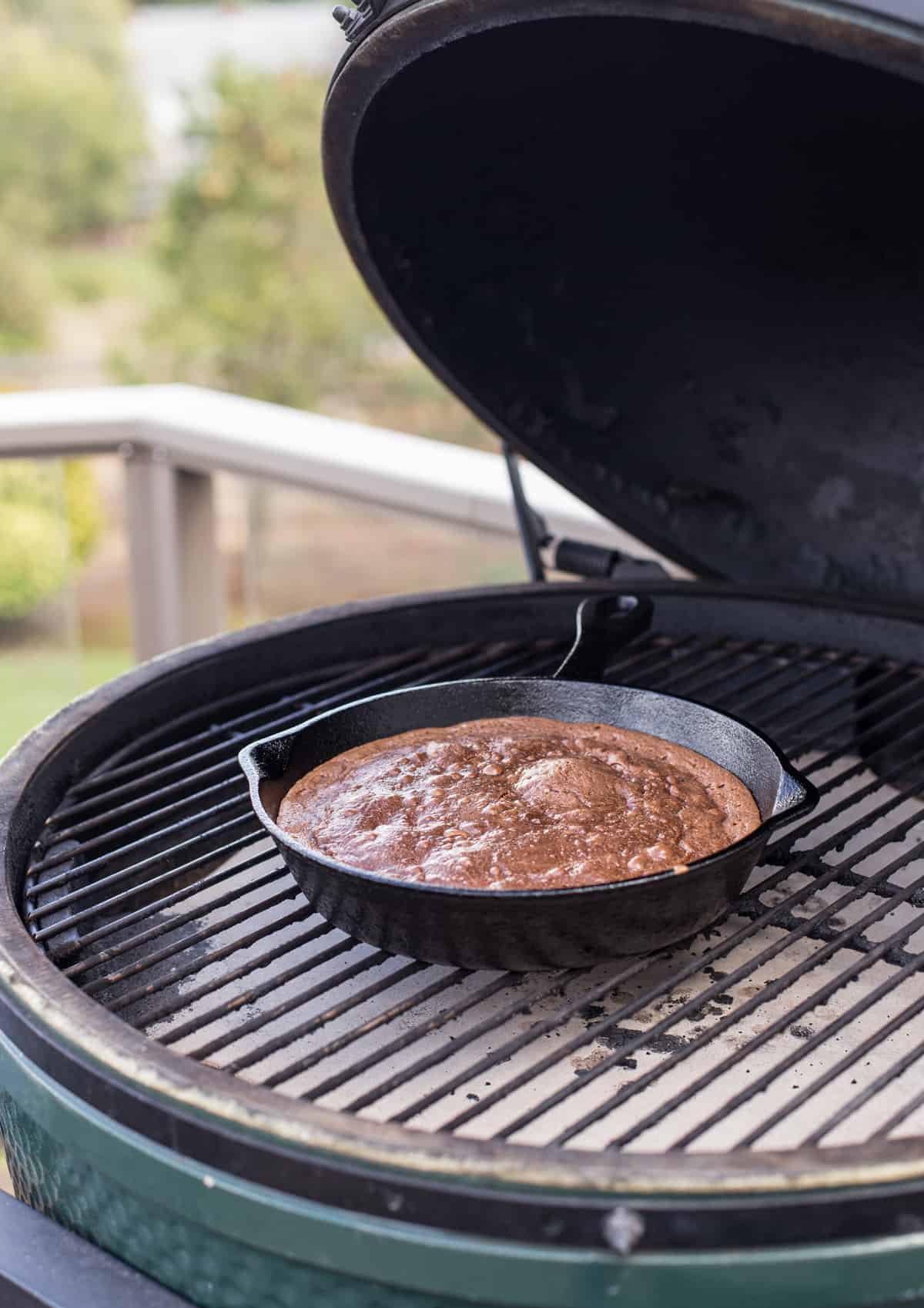 Cast Iron Pan full of brownies cooking on a Big Green Egg grill