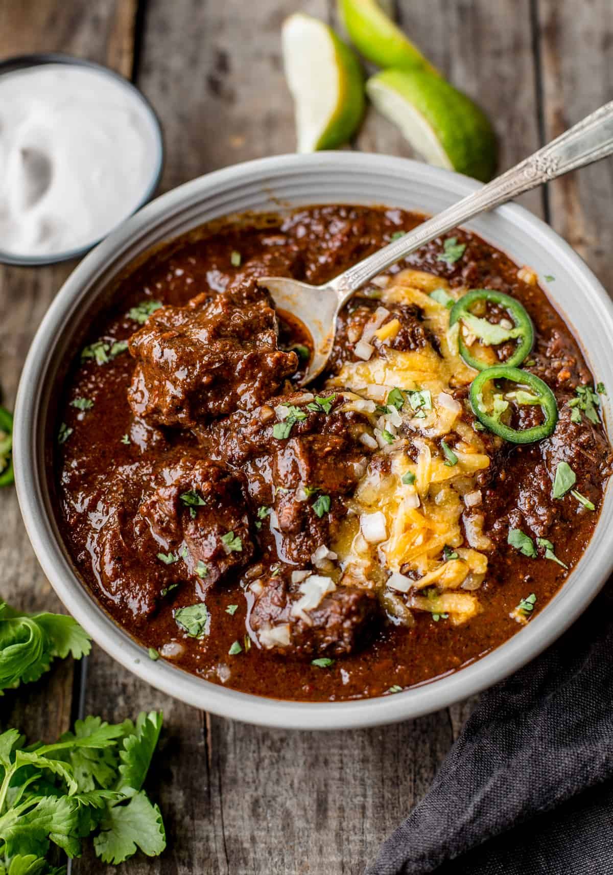 texas chili comfort food in a bowl with toppings.