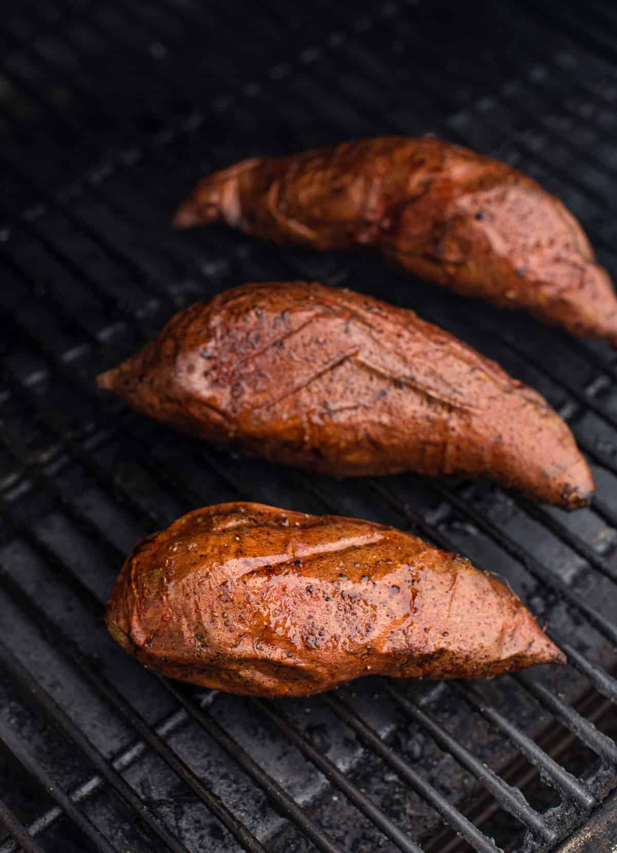 Sweet potatoes baking on the grill