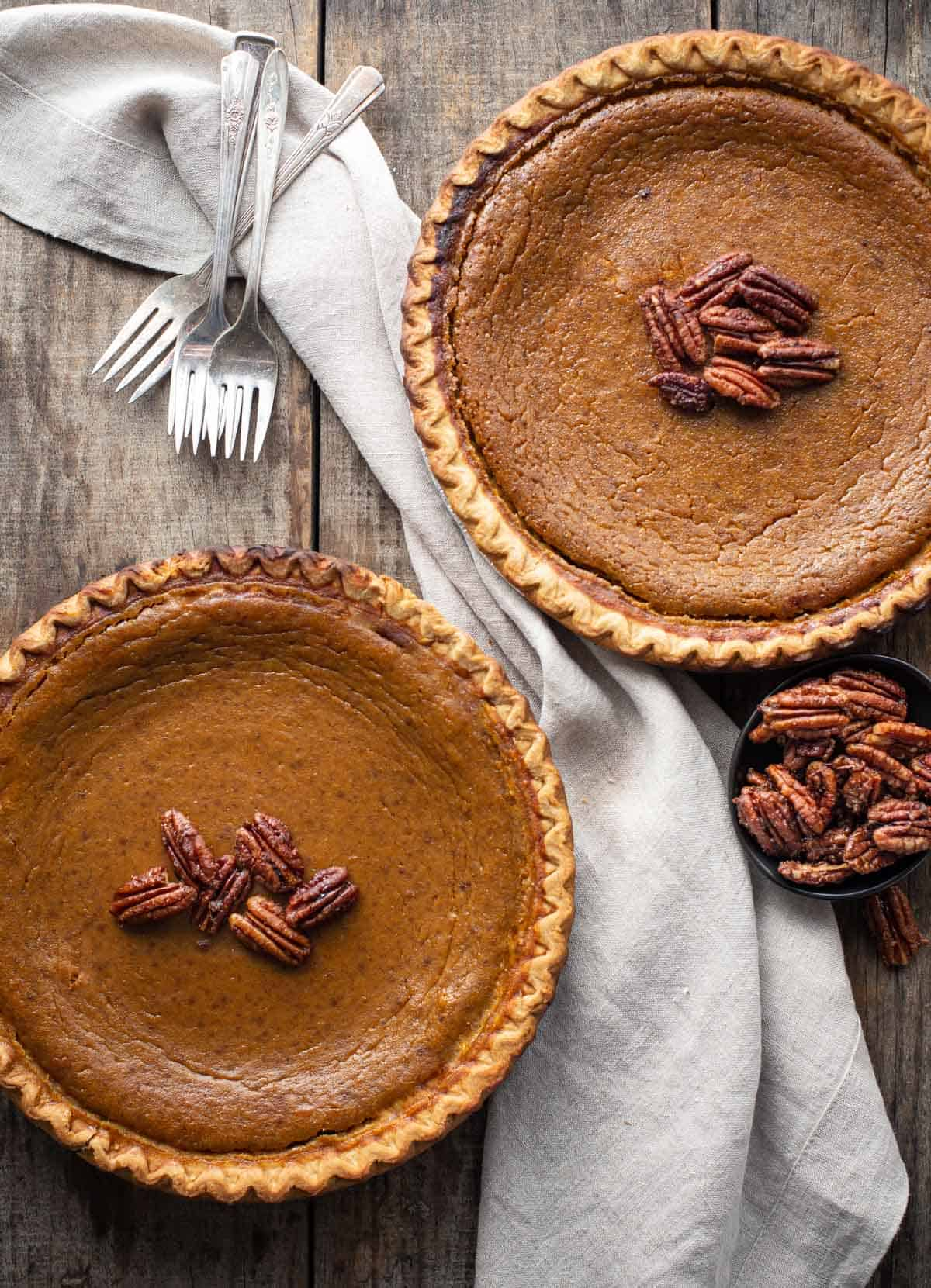 Two grilled pumpkin pies resting before serving