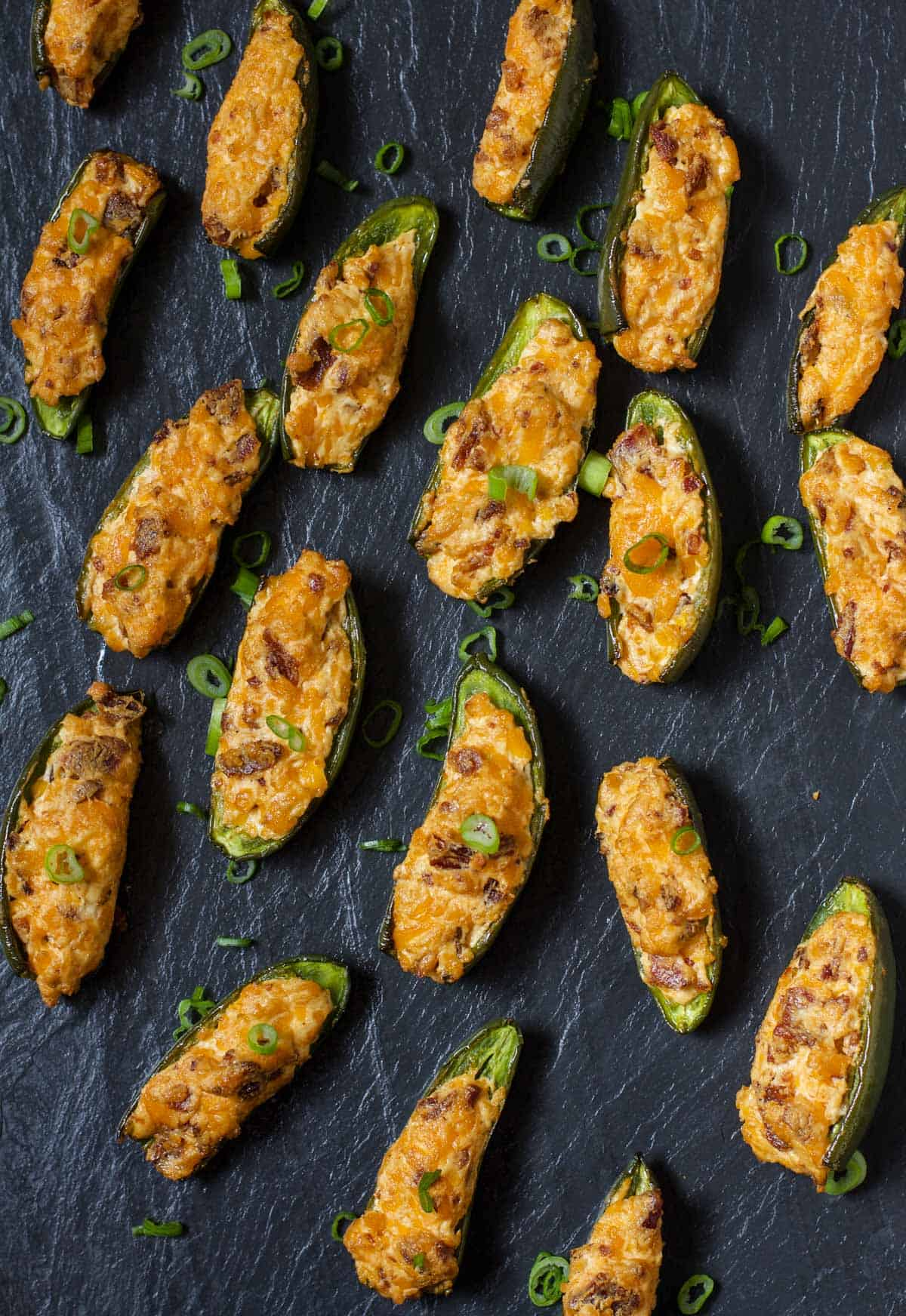 Smoked Jalapeño Poppers on a black slate platter