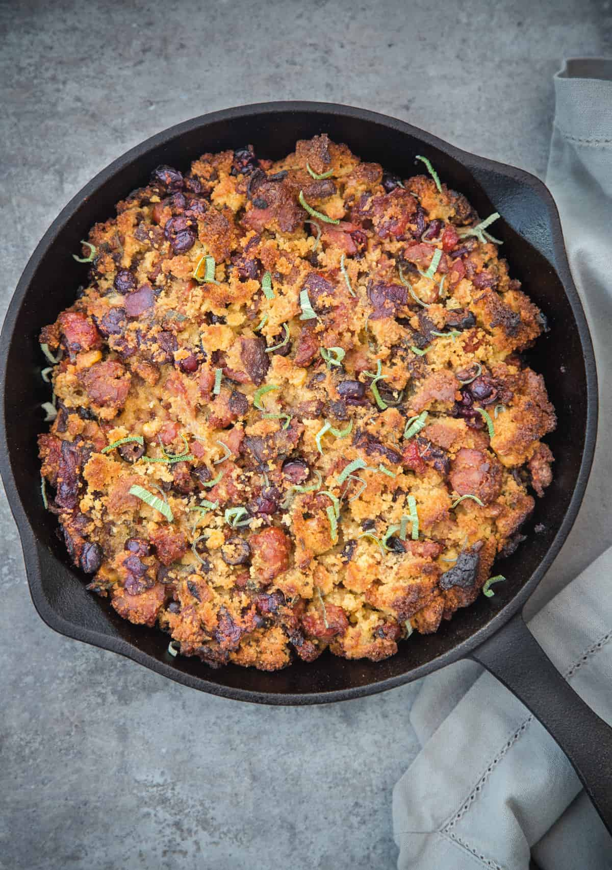 Smoked Sausage Cornbread stuffing in a cast iron pan.