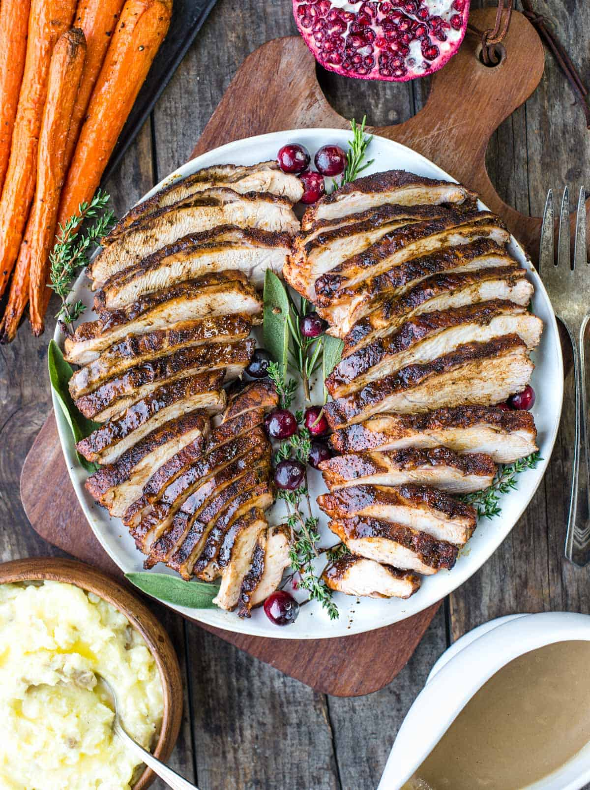 Sliced and grilled cajun spiced turkey breast with gravy and sides.