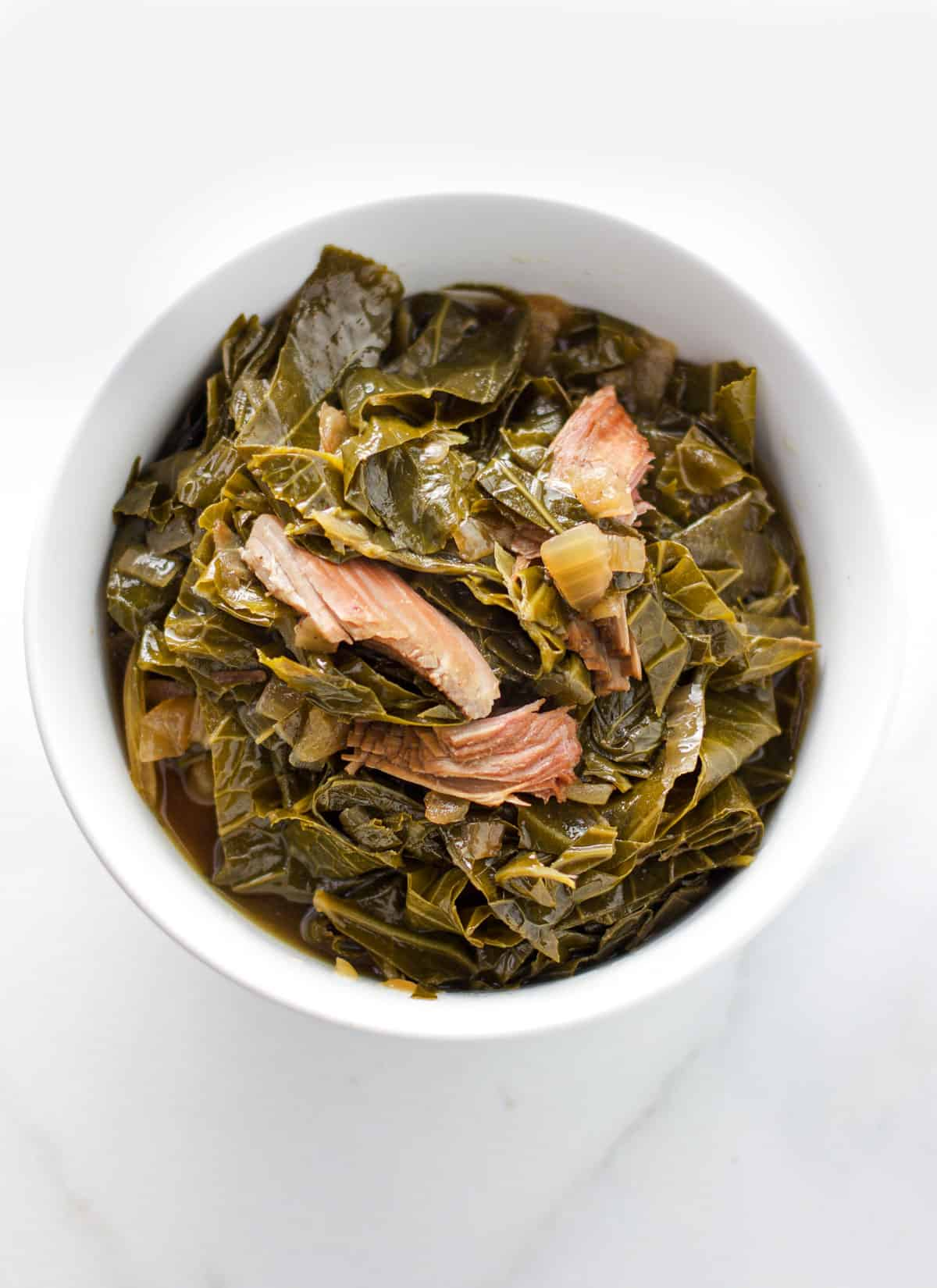Collard greens in a bowl with smoked turkey.