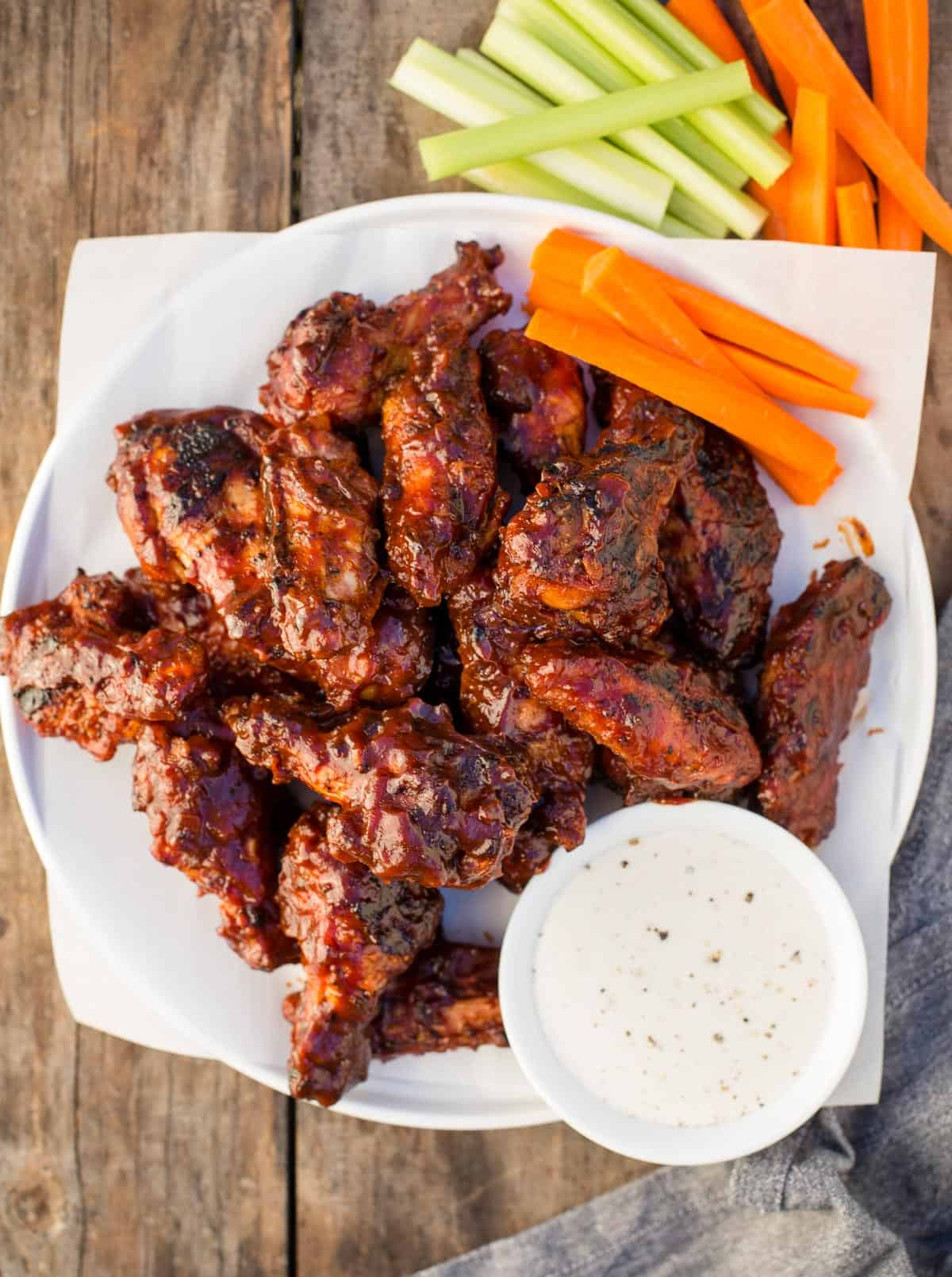 Grilled Chicken Wings with Crispy Skin on a white platter