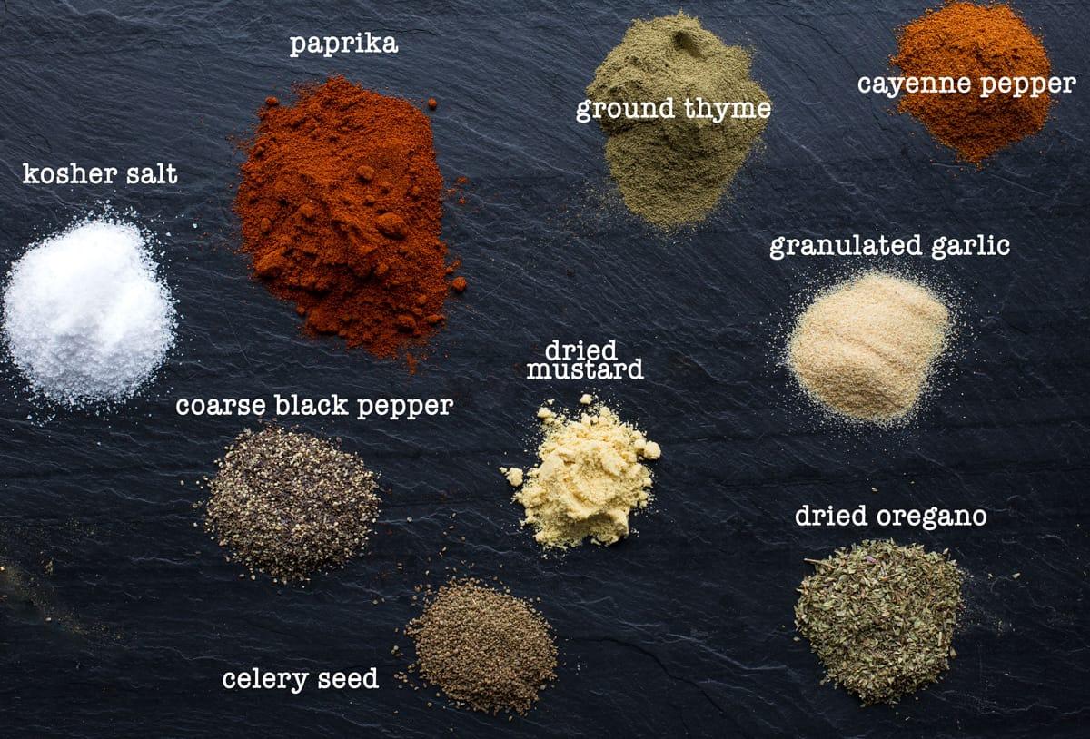 Ingredients for Cajun seasoning on a black slate plate