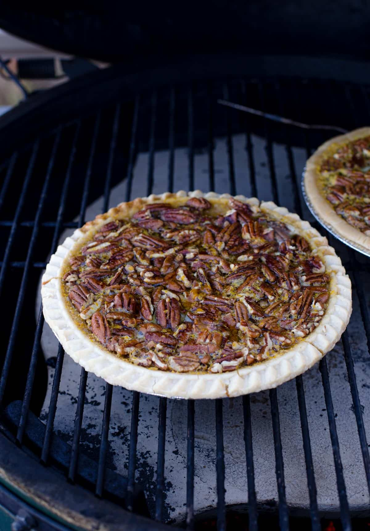 A pecan pie cooking on the grill
