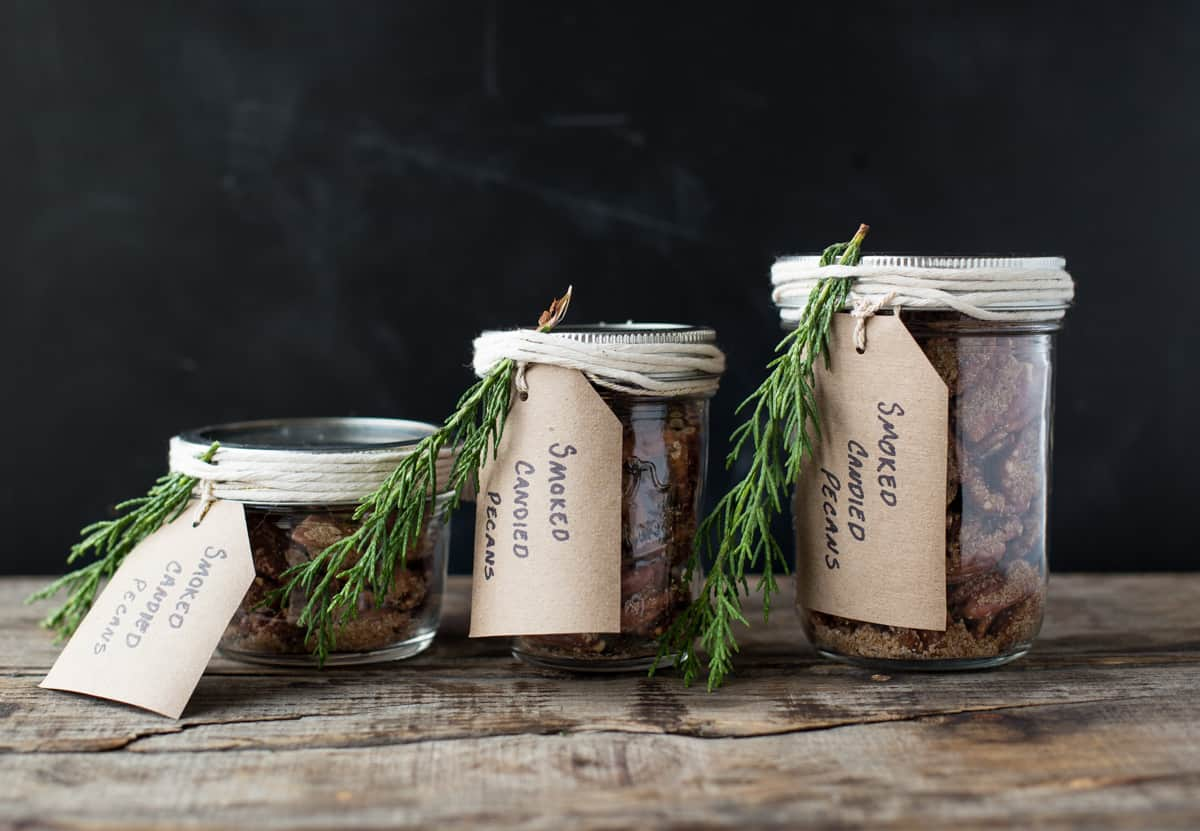 Three mason jars filled with smoked candied nuts