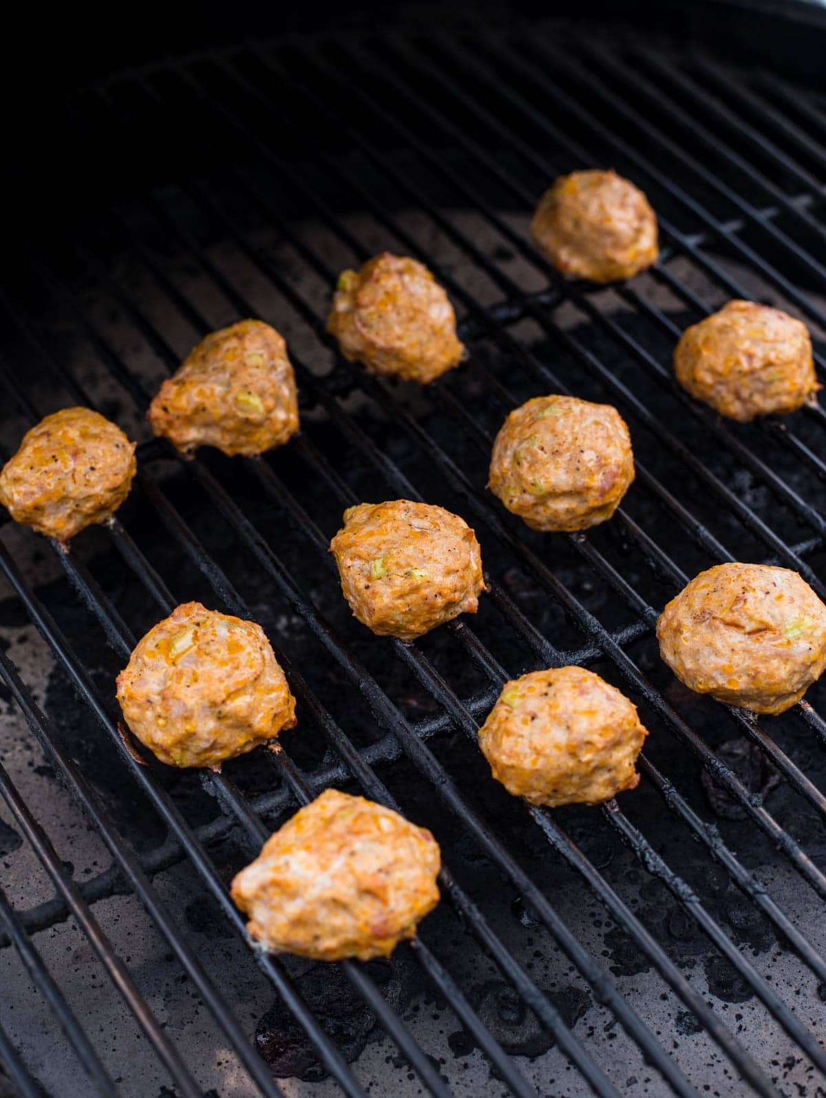 12 Meatballs cooking on a grill