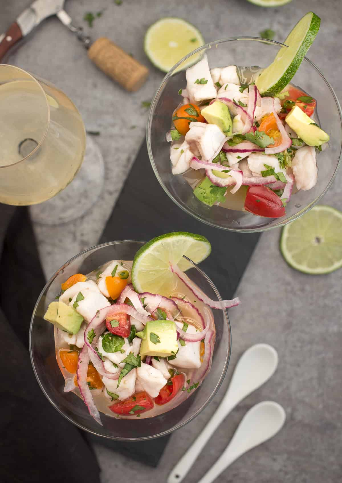Two glasses of Classic Ceviche and a glass of white wine