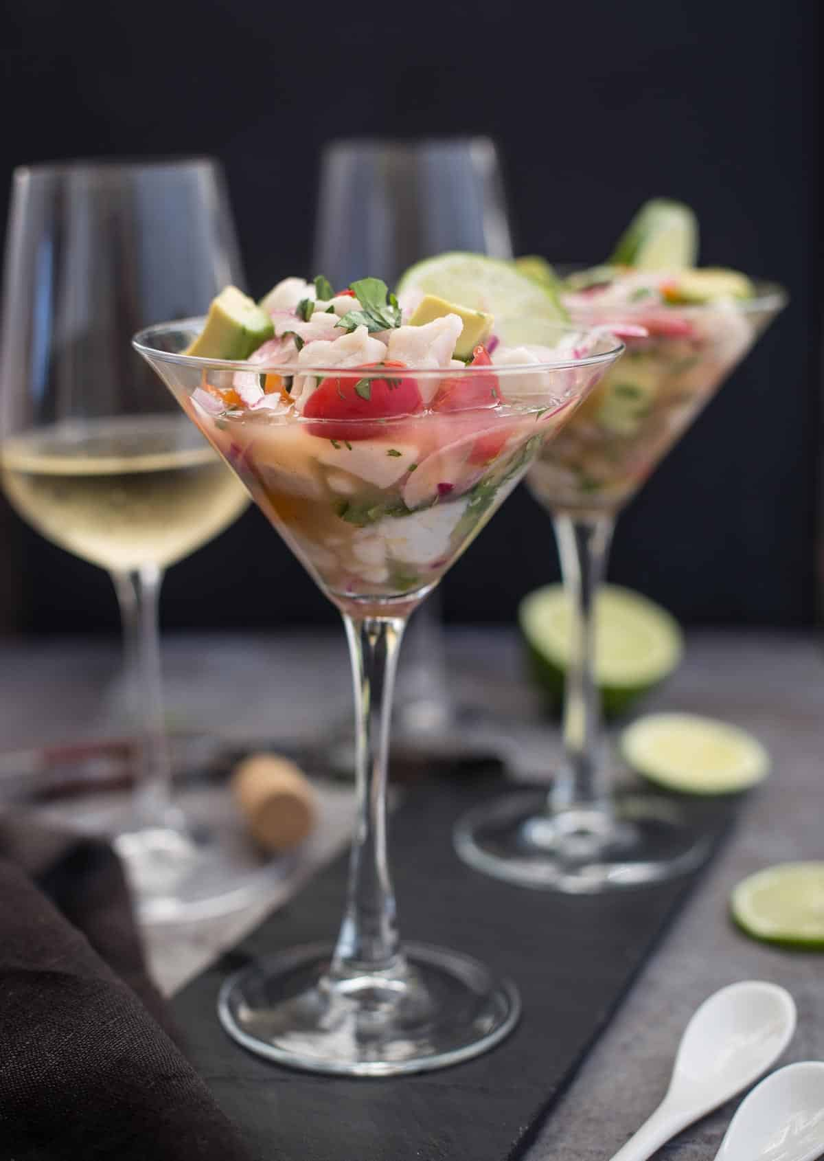 A glass with ceviche and a glass of Sauvignon Blanc wine
