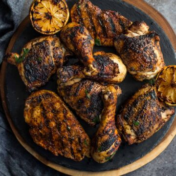 Jerk Grilled Chicken with dry rub on a plate.